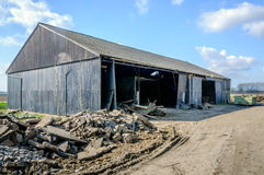 Old barn shortly before the demolition Royalty Free Stock Images