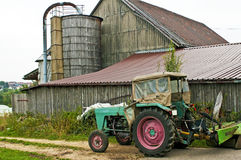 Old barn with silo and tractor Stock Photography