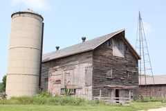 Old barn and silo. A weathered barn next to an old silo, part of America's disappearing landscape Stock Images