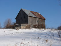 Old barn in snow. Old weathered barn in winter Royalty Free Stock Images