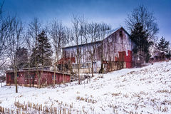 Old barn and a snow covered field in rural York County, Pennsylv Stock Photography