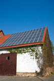 Old barn with solar cells Royalty Free Stock Photos