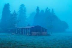 Old barn in spooky misty rural landscape. Old barn in a spooky misty rural landscape Stock Images