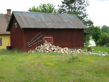 Old barn with a stack of firewood Royalty Free Stock Photography