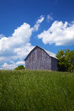 Old Barn with sunny back round Stock Photography