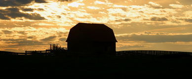 Old barn at sunrise royalty free stock photos