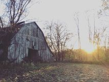 Old barn at sunset Stock Image