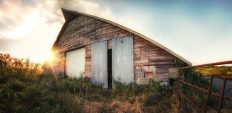 Old Barn at Sunset, Panoramic Color Image Stock Images