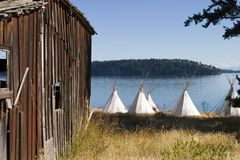 Old Barn and Teepees. An old barn with a group of teepees located nearby stock photos