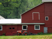 Old barn and tractor. A tractor waits its' next assignment aside an old barn in upstate New York Stock Photos
