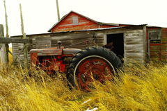 Old barn and tractor. Royalty Free Stock Photo