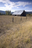 Old barn under a blue sky. Stock Photo