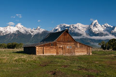 Old Barn Under Mountains Stock Images