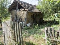 Romanian village. An old barn in the village of RoÈ™ia, MehedinÈ›i county, Romania stock photography