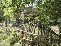 Romanian village. An old barn in the village of RoÈ™ia, MehedinÈ›i county, Romania royalty free stock photos