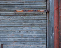 Old barn wall with hinge Stock Images