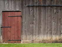 Old barn wall with red door Stock Image