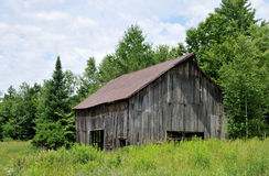 Old Barn. Old weathered barn in a field in rural Vermont stock images