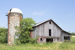 Old Barn and Weathered Silo Stock Images