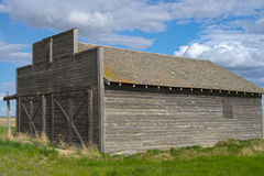 Old barn weathering time. Old barn in great shape weathering the years of abuse the prairies have to offer Royalty Free Stock Photo