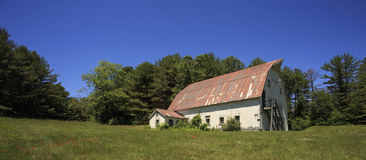 Old Barn Wide. An old New England barn in a pasture, wide panoramic Royalty Free Stock Photo