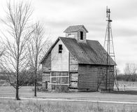 Old barn & wind mill. In black and white Stock Photography