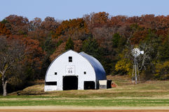 Old barn with windmill Royalty Free Stock Photos