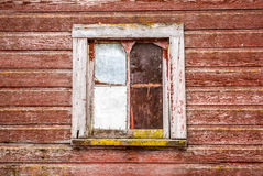 Old barn window. Rustic window on a red barn Royalty Free Stock Photography