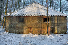 Old barn in winter woods Stock Images