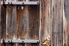 Old Barn Wood Door with Iron Hinges Stock Photo