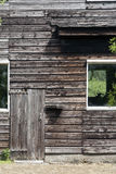 Old barn. Old wooden barn with big windows and a very small door Stock Photo