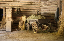 Old barn. Wooden cart with hay in old barn Stock Photos