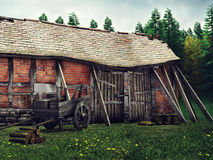 Old barn and wooden cart Stock Image