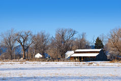 Old Barn and Wooden Fence on the Prairie Stock Photo
