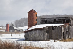 Old Barns. With brick silos in winter royalty free stock image