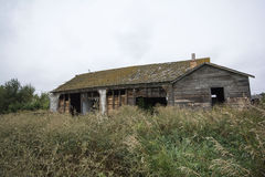 Old Barns. Old abandoned barns in a farmers field royalty free stock photos
