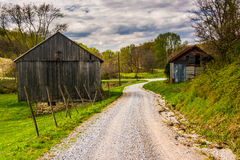 Old barns along a dirt road in rural York County, Pennsylvania. Royalty Free Stock Images