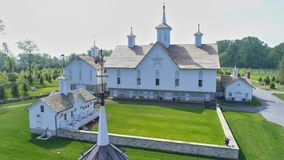 Old Barns with Cupola on a Sunny Day. Aerial View of a Old Barns with Steeple or Cupola as Seen by a Drone stock photo
