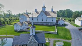Old Barns with Cupola on a Sunny Day. Aerial View of a Old Barns with Steeple or Cupola as Seen by a Drone royalty free stock photos