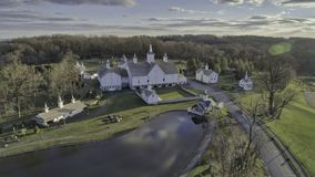 Old Barns with Cupola on a Sunny Day. Aerial View of a Old Barns with Steeple or Cupola as Seen by a Drone stock images
