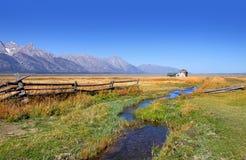 Old barns in Grand Tetons. Old Barns near Grand Tetons mountain range in Wyoming stock photos
