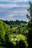 Old barns on a hill by the forest. In the Carpathians, Eastern Europe. Old wooden buildings and sheds are a typical picture of the Ukrainian province stock images