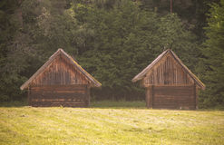 Old barns near the forest. Old wooden barns of the farmland, Lithuania royalty free stock photo
