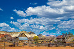 Old Barns. Rustic Old Farm With Barns and Corral And Cloudy Blue Sky Stock Photos
