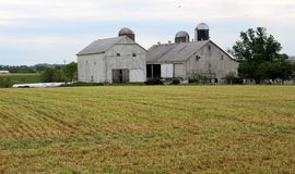 Old barns and silos in rural countryside Stock Photos
