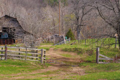 Old Barnyard. A view of an old barnyard with the old wooden fence stock photography