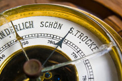 Old barometer. Photo of a fragment of a scale of an ancient barometer with the broken glass royalty free stock photo
