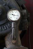 Old barometer connected to the old mechanical mashine Royalty Free Stock Photos