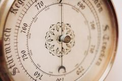 Old barometer dial close up with added grain. Old barometer dial close-up with added grain stock photography