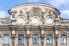 Old baroque building facade with elements of roof and windows. Royalty Free Stock Images